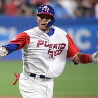 Yadier Molina and his Puerto Rico teammates will face the Netherlands in the semifinals of the 2017 World Baseball Classic at Dodger Stadium in Los Angeles on Monday. | USA TODAY / VIA REUTERS