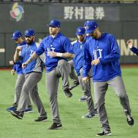 The Israel baseball squad holds a workout on Saturday at Tokyo Dome. The second round of the World Baseball Classic begins on Sunday. | KYODO