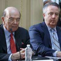 U.S. Commerce Secretary Wilbur Ross (left) sits next to Burlington Northern Santa Fe Railway CEO Matt Roselisten during a meeting with business leaders and President Donald Trump at the White House on Tuesday. | AP