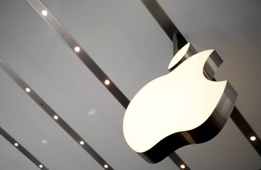 The Apple logo hangs inside the newly opened Omotesando Apple store in Tokyo in June 2014. | REUTERS