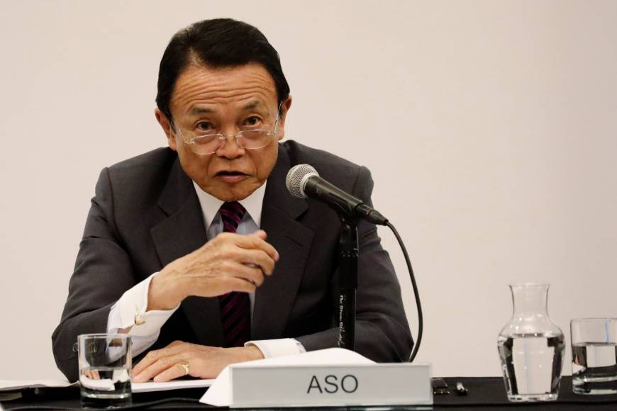 Finance Minister Taro Aso speaks at Columbia Business School in New York on Wednesday.   REUTERS
