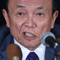 Aso wary of inking bilateral trade deal with U.S.