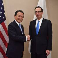 Deputy Prime Minister and Minister of Finance Taro Aso meets with U.S. Treasury Secretary Steven Mnuchin on Thursday in Washington. | AFP-JIJI