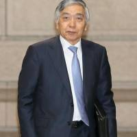 Bank of Japan cuts inflation forecast, maintains stimulus