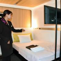 A 'first class' guest room at the new minimalist hotel First Cabin Kansai Airport is shown to the media last month at Kansai International Airport in Osaka. | KYODO