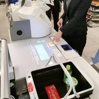 A fully automated register jointly developed by Lawson Inc. and Panasonic Corp. is seen at a convenience store in the city of Moriguchi, Osaka Prefecture, in December last year. | KYODO