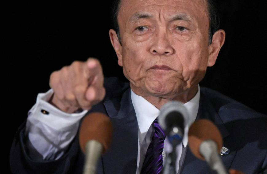 Finance Minister and Deputy Prime Minister Taro Aso speaks during a news conference in Washington on Friday. | AFP-JIJI