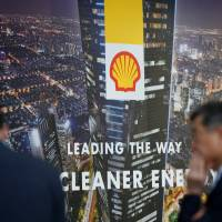 The Royal Dutch Shell logo is displayed at Gastech, the world's biggest expo for the gas industry, in Chiba Prefecture on Tuesday. | REUTERS
