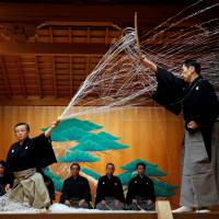 Noh performance master Kiyokazu Kanze performs with other actors at the Kanze Noh Theater ahead of its opening in Ginza Six on April 14. | REUTERS