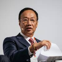 Billionaire Terry Gou, chairman of Foxconn Technology Group, speaks at the Asia-Pacific Conference of German Business in Hong Kong last November. | BLOOMBERG