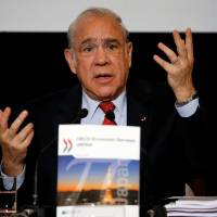 OECD Secretary-General Jose Angel Gurria attends a news conference at the Japan National Press Club in Tokyo on Thursday. | REUTERS