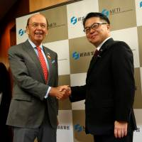 U.S. Commerce Secretary Wilbur Ross is welcomed by trade minister Hiroshige Seko at the start of their talks in Tokyo Tuesday. | REUTERS