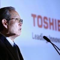Toshiba Corp. President Satoshi Tsunakawa speaks during a news conference at the company's headquarters in Tokyo on Tuesday. | AP