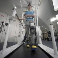 Toyota demonstrates robotic leg brace to help paralyzed people walk