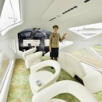 The new luxury sleeper train Train Suite Shiki-shima has an observation car that features numerous large windows. | KYODO