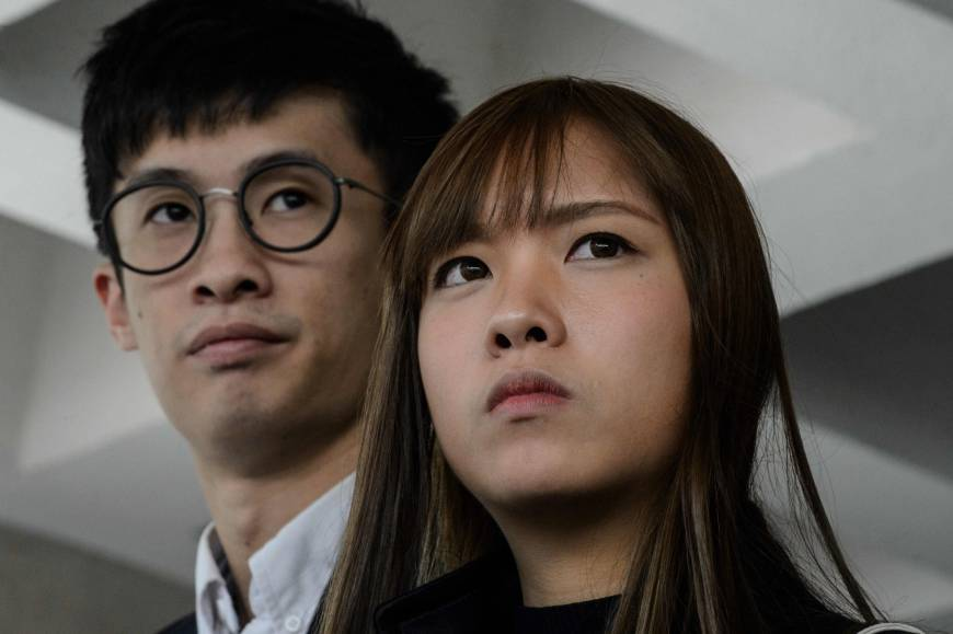 Pro-independence lawmakers Baggio Leung (left) and Yau Wai-ching speak to the media outside the High Court in Hong Kong in November.   AFP-JIJI