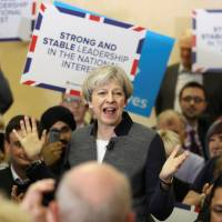 May's Conservatives on course for sweeping British election victory