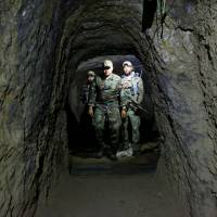 Afghan special forces on Sunday inspect a cave that was used by suspected Islamic State militants at the site where U.S. forces recently dropped the 'mother of all bombs' in the Achin district of Afghanistan's Nangarhar province. | REUTERS
