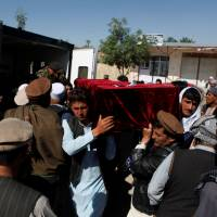 Relatives on Saturday carry the coffin of one of the victims of Friday's Taliban attack on Afghan soldiers at army headquarters in Mazar-i-Sharif. | REUTERS