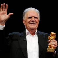 German cinematographer Michael Ballhaus holds an Honorary Golden Bear for his lifetime achievement at the 66th Berlinale International Film Festival in Berlin in 2016. | REUTERS