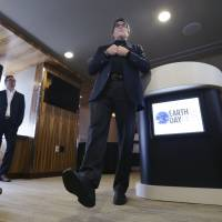 U.S. Energy Secretary Rick Perry speaks at a breakfast, part of an Earth Day event in Dallas on Friday. | AP