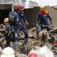 Colombia flood, slide death toll tops 210 amid desperate search for 200 more missing