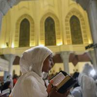 Copts gather at bombed church to mourn dead as Egypt arrests '13 terrorist elements'