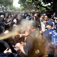 Immigration foe Coulter's Berkeley speech canceled as police brace for violence