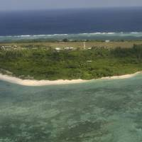 Pag-asa Island, part of the disputed Spratly Island group in the South China Sea, is shown on July 20, 2011, off the coast of western Philippines. Philippine President Rodrigo Duterte said Thursday that structures should be built on all of the nine to 10 islands, reefs and shoals held by the Philippines in the Spratly Islands. | AP