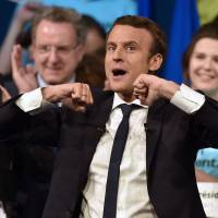 Populist EU foe Le Pen, centrist Macron in tight French presidential race