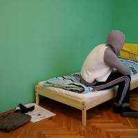 Fearing death at hands of state, kin, gays flee Chechnya for hidden life in Moscow