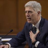 Gorsuch wades in on his first Supreme Court arguments