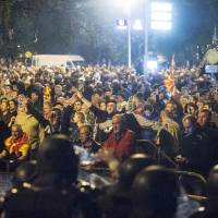 Protesters storm Macedonia parliament, rough up opposition leader