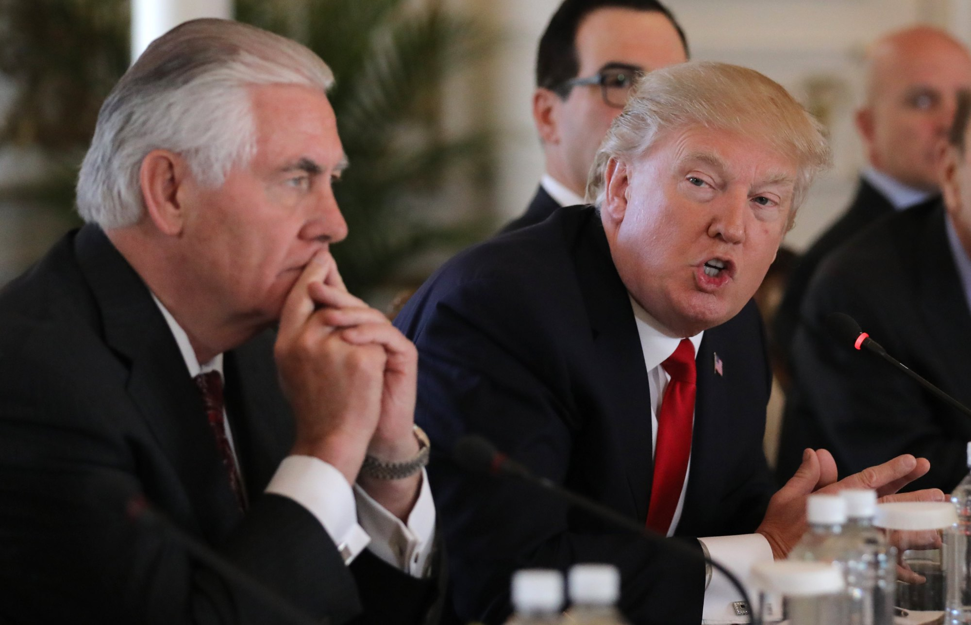 U.S. President Donald Trump speaks next to Secretary of State Rex Tillerson during a bilateral meeting with China's President Xi Jinping (not pictured) at Trump's Mar-a-Lago estate in Palm Beach, Florida, Friday. | REUTERS