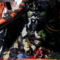 Facing threat of patrols, thousands of migrants fleeing Libya; 28 found dead