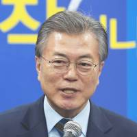 South Korean presidential contender Moon says he's open to direct talks with North's Kim