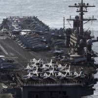 The U.S. Navy aircraft carrier USS Carl Vinson approaches the port of Busan on March 15 ahead of its  participation in annual joint military exercises with South Korea. | AP