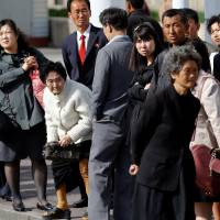People wait for the bus in central Pyongyang Wednesday. | REUTERS