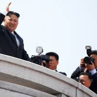 North Korean leader Kim Jong Un waves while attending a military parade marking the 105th anniversary of the birth of the country's founding father, Kim Il Sung, in Pyongyang on Saturday.   REUTERS