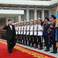 This photo, taken Saturday and released by the official Korean Central News Agency on Sunday shows North Korean leader Kim Jong Un arriving for a military parade in Pyongyang to mark the 105th anniversary of the birth of late North Korean founder Kim Il Sung.   AFP-JIJI