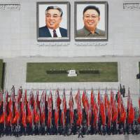 People practice Wednesday for an expected parade on Pyongyang's main Kim Il Sung Square set for Saturday, the 105th anniversary of the birth of North Korean founder Kim Il Sung. | REUTERS