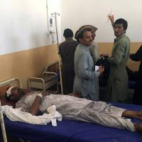 A Pakistani bombing victim is treated at a hospital in the tribal district of Kurram on Tuesday. At least nine people were killed, including women and children, and 13 others injured when a passenger vehicle struck a roadside bomb in Pakistan's northwest tribal region bordering Afghanistan. | AFP-JIJI