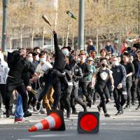 6,000 march in Paris over Chinese man's fatal shooting by police