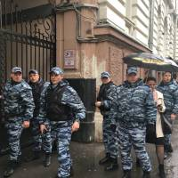 Putin foe's Moscow office raided; another opponent doused with chemical