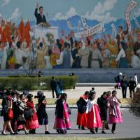 Women wear traditional clothes as North Korea prepares to mark Saturday's 105th anniversary of the birth of Kim Il Sung, North Korea's founding father, in central Pyongyang on Wednesday. | REUTERS