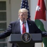 President Donald Trump speaks during a news conference with Jordan's King Abdullah II in the Rose Garden of the White House in Washington Wednesday. | AP
