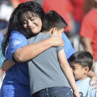 Hugs, bubbles, teddy bears greet kids returning to school after deadly shooting
