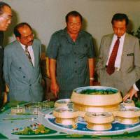 A 1998 handout image obtained from MKP's company profile booklet shows Malaysia's prime minister at the time, Mahathir Mohamad (center right), looking at a model of the Kedah Padi Museum project that the Malaysia-Korea Partners (MKP) helped build | REUTERS