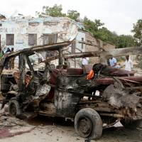 Somalia's new army chief survives but 13 others killed in car bombing blamed on al-Shabab