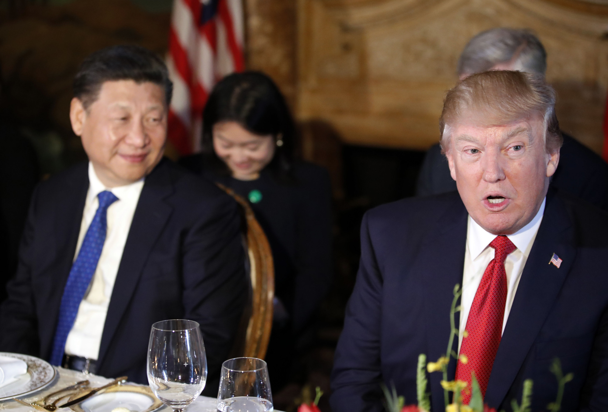 U.S. President Donald Trump and Chinese President Xi Jinping attend a dinner at Mar-a-Lago  on Thursday in Palm Beach, Florida. | AP